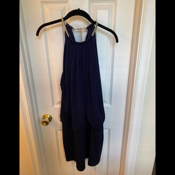 Short navy dress, tight on legs, loose on top